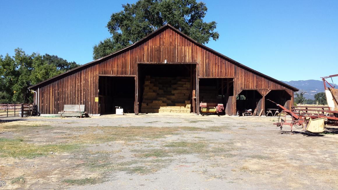 Large barn with storage and stalls