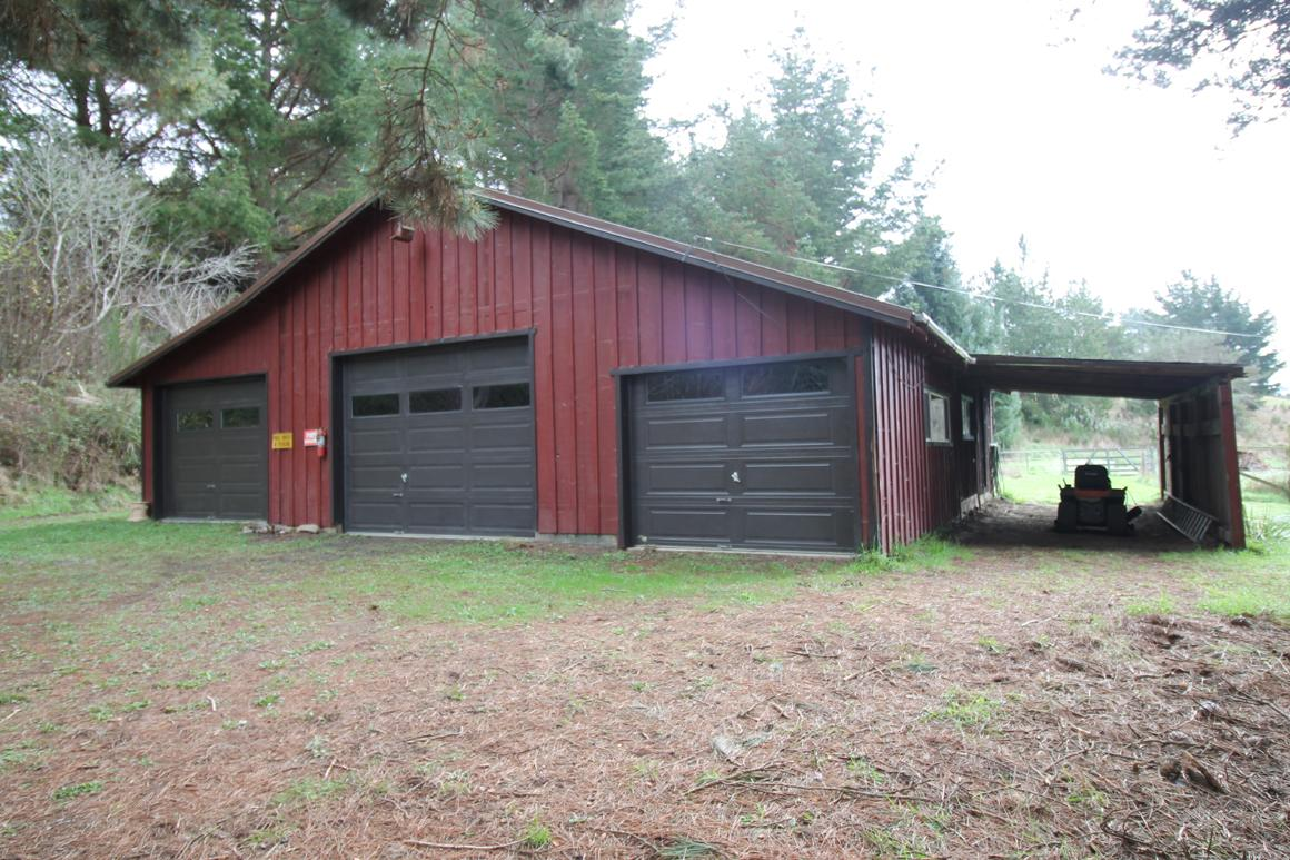 Barn-style 3 bay garage plus shop