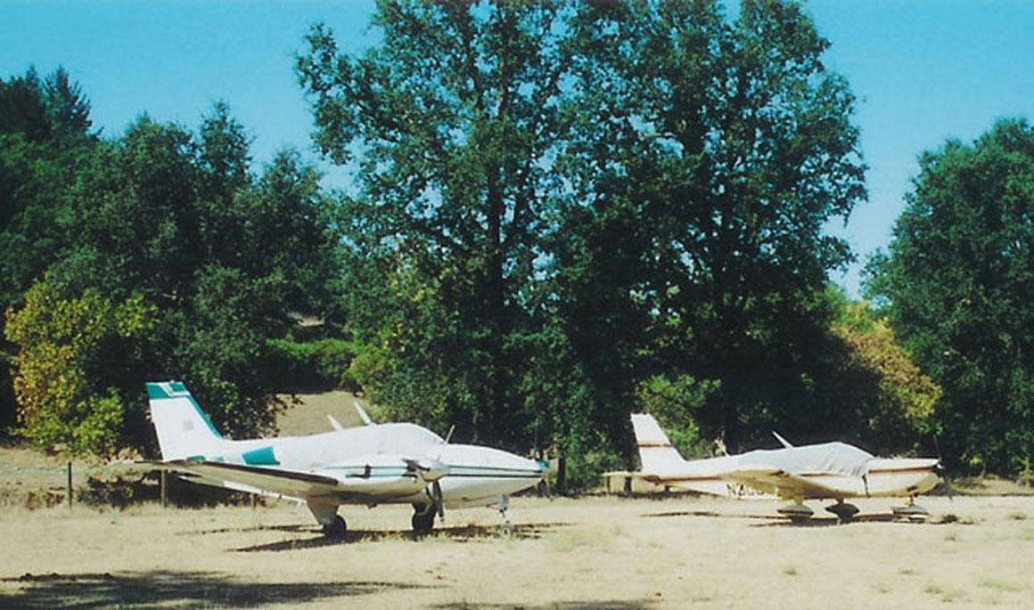 Planes tied down, off the landing strip