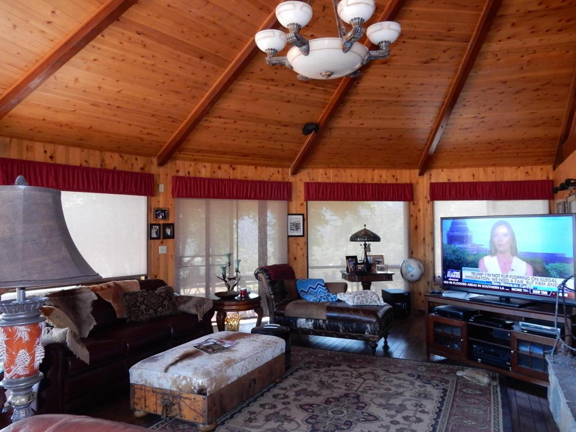 Vaulted open beam living room with views